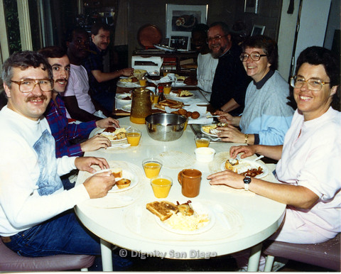 P103.084m.r.t Dignity San Diego: Group of men and women eating breakfast