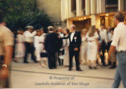 P024.136m.r.t Myth California Protest, San Diego, June 1986: blurry photo of people standing in front of the Civic Theatre
