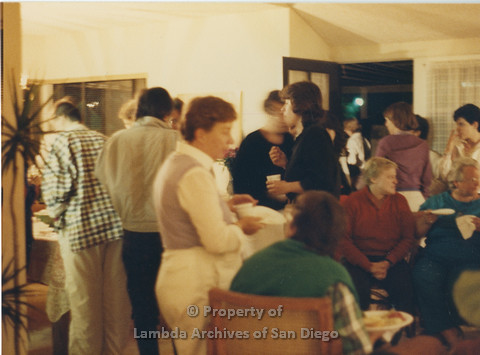 Alix Dobkin Concert, 1985 in the home of Carol Cianfarani: Audience members enjoying refreshments during the reception for Lesbian, Feminist, Jewish, Folk Singer - Alix Dobkin.