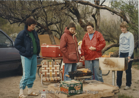 P024.050m.r.t Cathy Moore's 34th Birthday, Halley's Comet Weekend, Anza Borrego Desert 1986: Four women around BBQ.