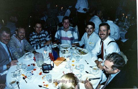 P103.131m.r.t Dignity Ninth Biennial Convention, San Francisco, 1989 : Eight men eating at event