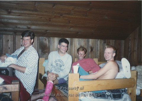 P001.184m.r.t Retreat 1991: men on and around bunk beds, one has a pink leg-cast