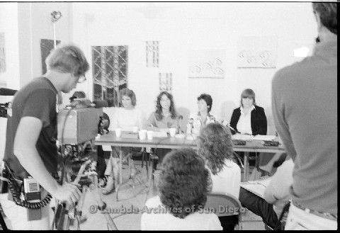 P123.016m.r.t Dixon Press Conference 1982:  (Left to Right)Chris Russell, Kathy Gilberd (MLTF, NLG), Diane Cooper (NOW/SD), Susan McGreivy (ACLU) sitting while Kathy speaks