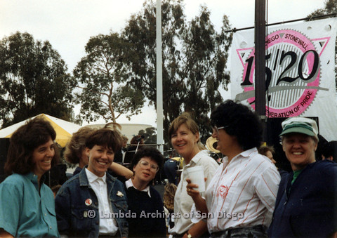 P024.475m.r.t 1990 San Diego Pride festival: (from left to right) Diane Besemer, Pamela Gusha, unknown woman, Sandy Johnson, Joyce Mariel, and Sally Hopkins smiling