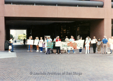 "P024.552m.r.t Group of people with signs, center sign reads ""Wage Peace, Vote '88"""