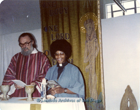 P110.057m.r.t Metropolitan Community Church: Joseph Gilbert reading from paper while a religious leader holds a book.