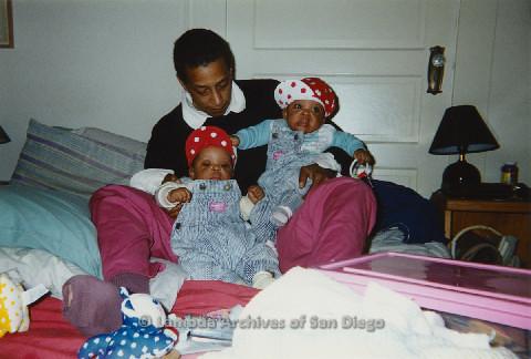 P125.013m.r.t Marti Mackey craddling Phyllis Jackson's grandchildren