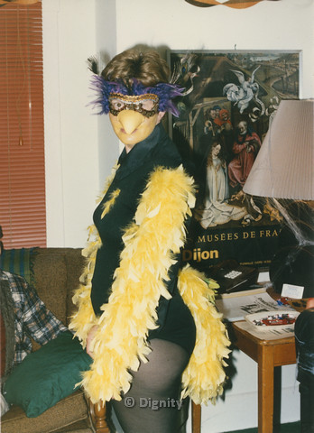 P104.095m.r.t Dignity San Diego: Person wearing mask with a feathered leotard
