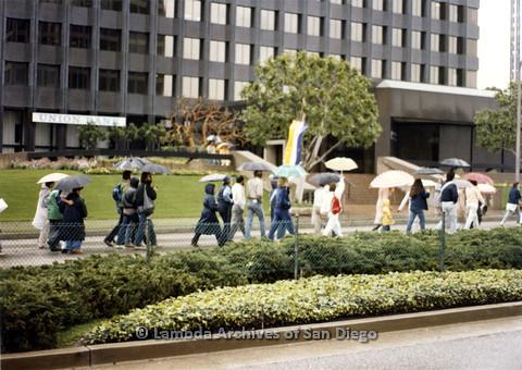 P024.542m.r.t People with umbrellas walking