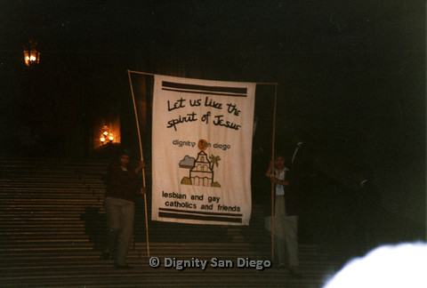 P103.122m.r.t Dignity Ninth Biennial Convention 1989: Two people holding up sign for Dignity San Diego