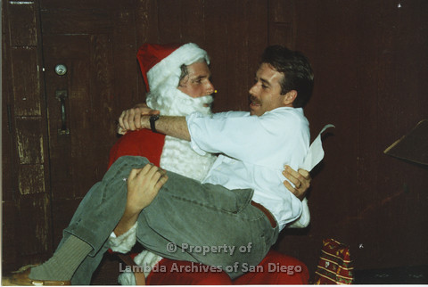 P001.293m.r.t X-mas:man in white shirt sitting on Santa's lap