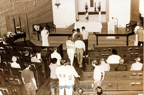 P103.056m.r.t Dignity San Diego: Group of church goers rising to line-up in the isle