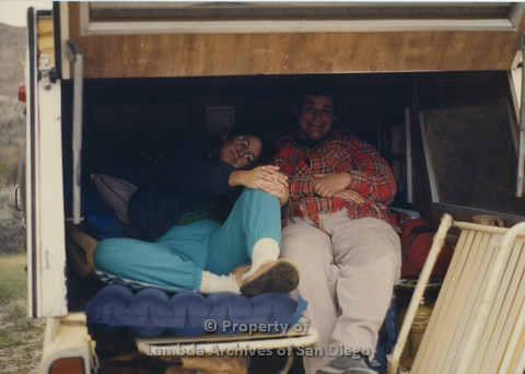 P024.055m.r.t Cathy Moore's 34th Birthday, Halley's Comet Weekend, Anza Borrego Desert 1986: Sheila Shanahan and Nancy Gordon sitting in the camper of a truck.