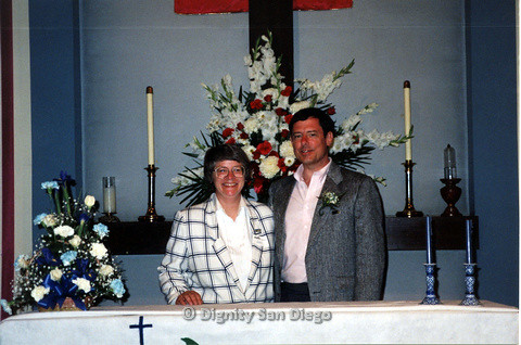 P103.148m.r.t Lucy and an unkown man smiling for camera at Dignity San Diego alter