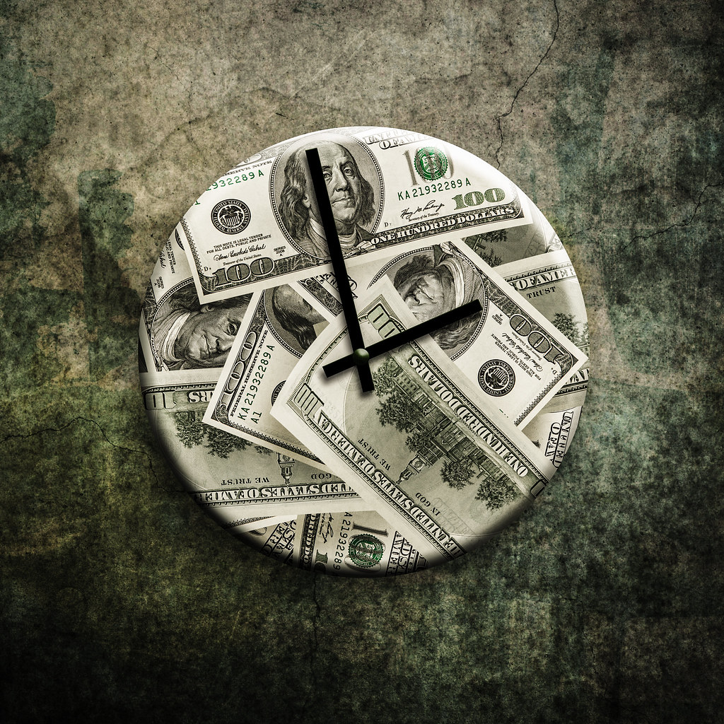 Time Is Money A Clock With Money On It