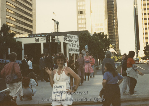 P024.100m.r.t Myth California Protest, San Diego, June 1986: Karen Merry with sign around her neck (I Want a Scholarship Too!)