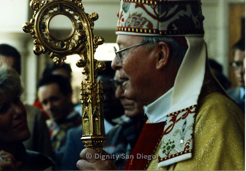 P103.064m.r.t Dignity San Diego: Close-up shot of Bishop with golden scepter