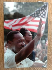 "Martin Luther King, Jr. waves to the crowd at the final rally of the ""March Against Fear"" at the Mississippi State Capitol in Jackson Mississippi on June 1, 1966."