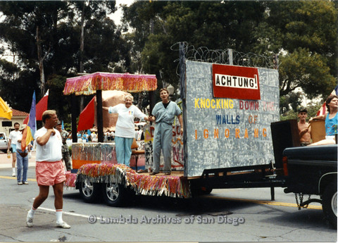 P024.416m.r.t 1990 San Diego Pride parade: two women on a parade float