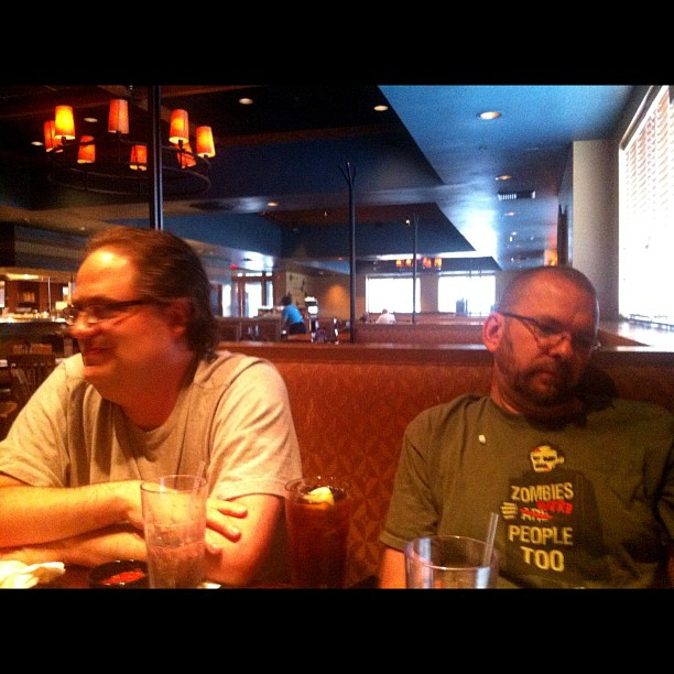 Proof that @tapbot_paul (left) does leave his hermit hole. @agiletortoise checking live blog of iPad mini announcement.