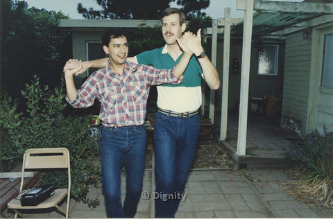 P104.110m.r.t Dignity San Diego: Rick Duffer (left) holding hands with another man while they dance in a patio