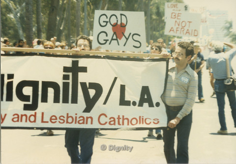 P104.132m.r.t Dignity L.A. at San Diego Pride Parade: Dignity L.A. contingent marching behind banner and streamers.