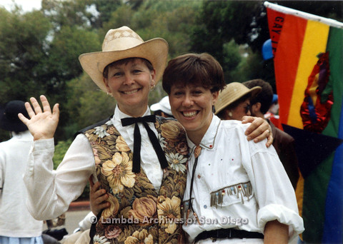 P024.446m.r.t 1990 San Diego Pride Parade: Diane Germain on left with arm around Pamela Gusha.
