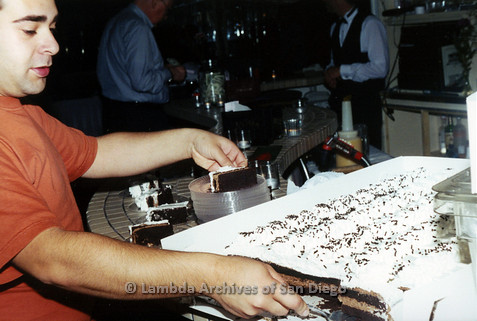 P040.181m.r.t SAGE General Meeting; Man cutting cake