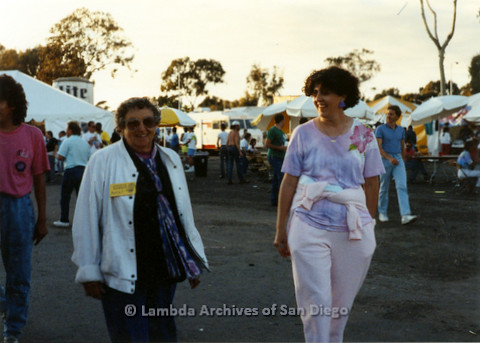 P024.450m.r.t 1990 San Diego Pride festival: Muriel Fisher on left of unknown woman in pink and purple.