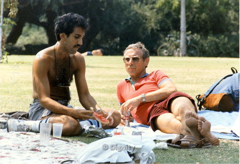 P104.047m.r.t Dignity Picnic 4th of July: Man with hairy chest and man in orange polo relaxing at the park