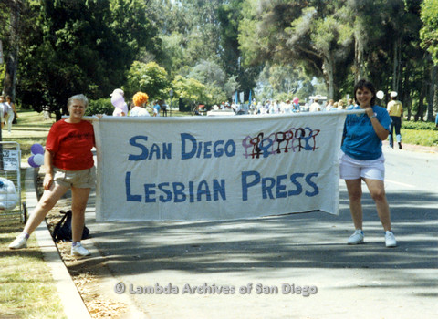 P024.506m.r.t 1990 San Diego Pride Parade: Sally Hopkins (on left) and another woman holding up a San Diego Lesbian Press banner