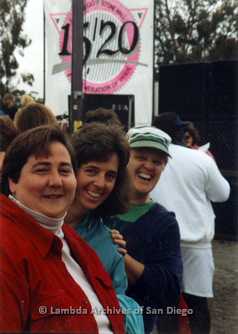 P024.511m.r.t 1990 San Diego Pride: (Left to right) Edna Myers, Diane Besemer, and Sally Hopkins taking a photo