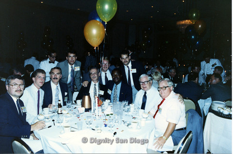 P103.121m.r.t Dignity Ninth Biennial Convention 1989: Men sitting around table with balloons and confetti