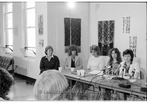 P123.004m.r.t Dixon Press Conference 1982:  (Left to Right) Robin Bruce, Fran Ledford, Chris Russell, Kathy Gilberd (MLTF, NLG), Diane Cooper (NOW/SD) speaking in microphones