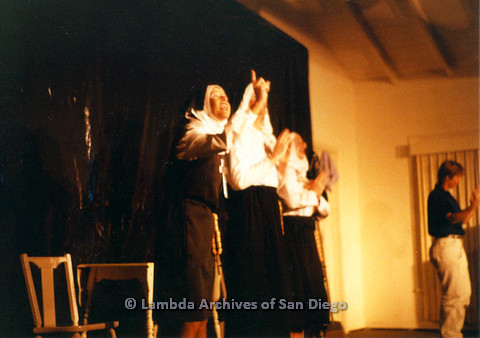 P024.164m.r.t Beautiful Lesbian Thespian performers in nun habits standing and looking up