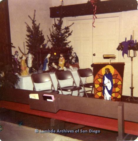P110.033m.r.t Metropolitan Community Church: Empty seets in front of Nativity scene.