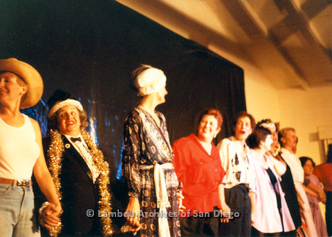 P024.190m.r.t  Judith McConnell (center) and Diane Germain (left in cowboy hat) about to bow with rest of the cast