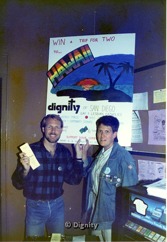 P104.013m.r.t Dignity San Diego: Bruce Neveu and a woman holding up sign for Dignity San Diego raffle