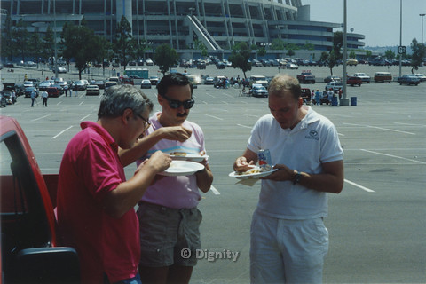 P104.074m.r.t Dignity San Diego: Three men eating at the Qualcomm Stadium parking lot