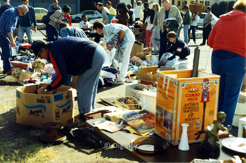 P104.002m.r.t Dignity church and MCC yard sale: slightly blurry shot of a large group of people going through boxes