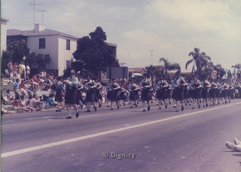 P104.137m.r.t San Diego Pride Parade: Parade line of men in kilts playing bagpipes.