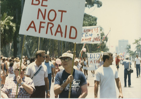 "P104.121m.r.t Dignity L.A. at San Diego Pride Parade: Marchers in parade holding signs with prominent ""BE NOT AFRAID"" sign in foreground."