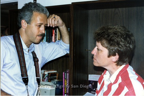 P103.189m.r.t Dignity San Diego: A man and woman in front of a bookcase