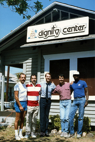 P103.167m.r.t San Diego Dignity Center: Five men standing at front of Center smiling underneath sign. Bruce Neveu at center
