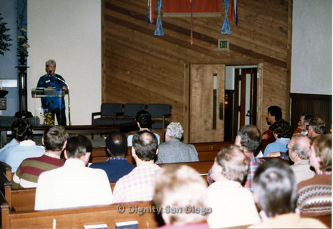 "P103.089m.r.t Dignity San Diego: ""Heather"" speaking to the congregation during church"