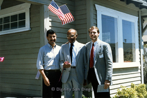 P103.172m.r.t San Diego Dignity Center: Three men standing in front of Center. Left to right: Henry Ramirez, Leon Williams, Bruce Neveu