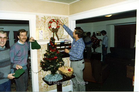 P103.199m.r.t Dignity San Diego: Men hanging Christmas stockings and wreath
