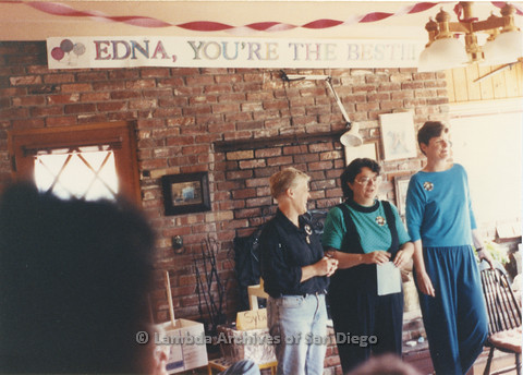 P024.370m.r.t (left to right) Sally Hopkins, Michael Ann, and Judith McConnell  stand before a banner