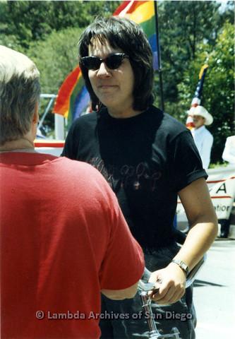 P024.507m.r.t 1990 San Diego Pride: Unknown woman in a black San Diego Lesbian Press T-shirt