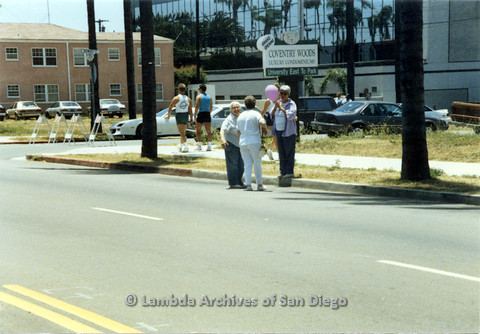 P024.533m.r.t 1990 San Diego Pride: Barbara Macdonald (on left) and Cinthia Rich (with a pink balloon) across the street with an unknown woman